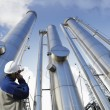 Gas pipelines and worker - Stock Photo