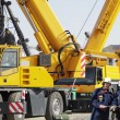 Giant mobile cranes and site-workers — Stock Photo #9573222