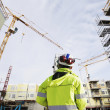 Construction site and geodetist - Stockfoto