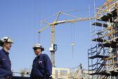 Construcción y trabajadores del sitio — Foto de Stock