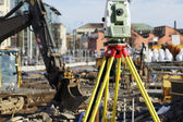Geodesy measuring inside building site — ストック写真