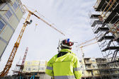 Construction site and geodetist — Stock Photo