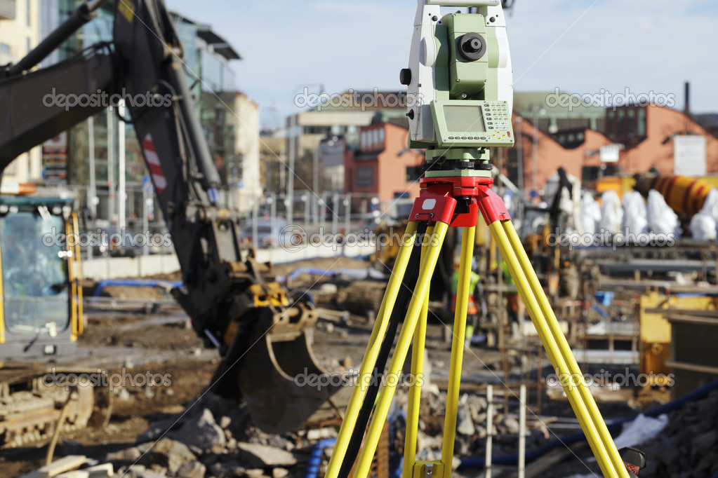 Large geodesy equipment for measuring, typical scene inside construction site — Stock Photo #9573177