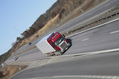 Truck driving on highway — Stock Photo