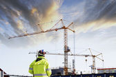 Geodesy engineer and construction at sunset — Stock Photo