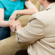 Depressed girl gets counseling and comfort from a caring therapist. — Stock Photo #10125954