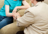 Depressed girl gets counseling and comfort from a caring therapist. — Stock Photo