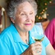 Stock Photo of Wine Tasting - Senior Woman - Stock Photo