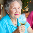 Stock Photo of Wine Tasting - Senior Woman — Stock Photo