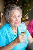 Stock Photo of Wine Tasting - Senior Woman — Stock Photo