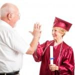 Senior Couple - Graduation High Five — Stock Photo #10721484