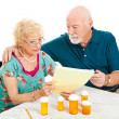 Senior Couple - Medical Bills - Stock Photo