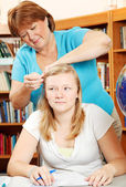 Fixing Daughter's Hair — Stockfoto