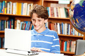 Boy Uses Computer in School — Stock Photo