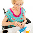 Disabled Woman Takes Medicine - Stock Photo