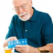 Senior Man Sorting Pills — Stock Photo #8851348