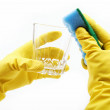 Royalty-Free Stock Photo: Ands in rubber gloves, sponge wash the glass on a white backgrou