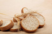 Fresh bread isolated on a light brown background. — ストック写真