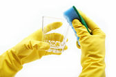 Ands in rubber gloves, sponge wash the glass on a white backgrou — Stock Photo