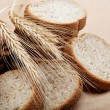 Fresh bread isolated on a light brown background. — Stock fotografie