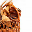 Fresh bread in the basket fully isolated. — Stock Photo