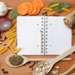Notebook for recipes and spices on wooden table — Stock Photo #10279217