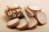Fresh bread isolated on a light brown background. — Stockfoto