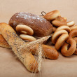 Fresh bread isolated on a light brown background. — Stock Photo