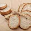 Stock Photo: Fresh bread isolated on light brown background.