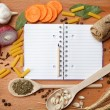 Notebook for recipes and spices on wooden table — Stock Photo #10551466
