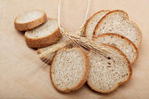 Fresh bread isolated on a light brown background. — Foto de Stock