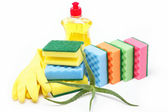 Detergent bottle, rubber gloves and cleaning sponge on a white b — Stock Photo
