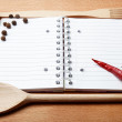 Notebook for recipes and spices on wooden table — Stockfoto #10655226