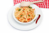 Rice in a bowl on a white background. — Stock Photo