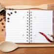 Notebook for recipes and spices on wooden table — Stockfoto #10721328