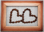 Two Hearts of coffee beans in frame. — Stock Photo