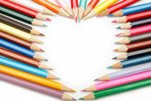 Colored pencils crayons composed in the form of heart — Stock Photo