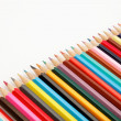 Color pencils crayons in arrange in color wheel colors on white — Stock Photo