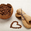 The heart of the coffee beans in a linen cloth. — Stock Photo