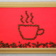 Foto de Stock  : Picture cup of coffee beans in frame on red background on