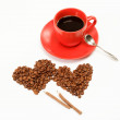 Two hearts made from coffee beans around a cup of coffee o — Stock Photo #8939597