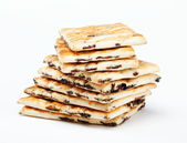 A stack of cookies with caramel filling on a white background. — Stock Photo