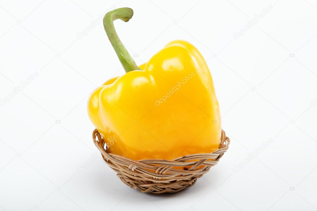 Bulgarian yellow peppers in a basket on a white background. — Stock Photo #9134791