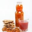 Light lunches. Crunchy biscuits and juice on a white background. — Stockfoto