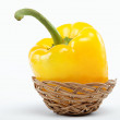 Royalty-Free Stock Photo: Bulgarian yellow peppers in a basket on a white background.