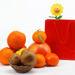 Red Gift Bag and citrus fruits on a white background. — Stock Photo