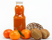 Juice and citrus fruits on a white background. — Stock Photo