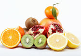 Tropical fruits on a white background. — Stock Photo
