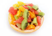 Fresh fruits salad on white background — Stock Photo