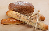 Fresh bread on a light brown background. — Stock Photo